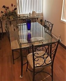 The other dining set, both with matching chairs.