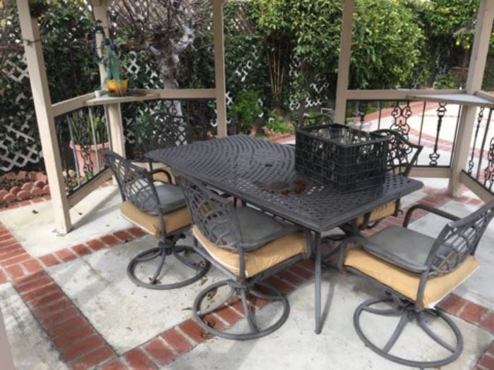 This photo shows the patio table and matching chairs.