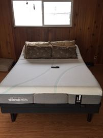 The Tempur-pedic bed, probably a full-size.