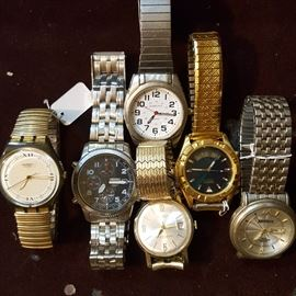 Several brand-name men's watches -- all in running condition