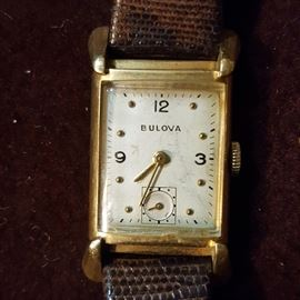 Antique, Swiss-made Bolova watch, in 14k gold. Watch runs and keeps time