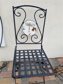 Folding wrought iron chairs