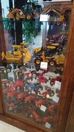 SHELF 1=CASE 580 SUPER M, SHELF 2= J.D. 650H CAT, J.D. PRECISION 544J, SHELF 3= FORD 9N,2N,8N,2 BOTTOM PLOW, NAA GOLDEN JUBILEE SHELF 4= 641 LOADER,5000 DIESEL, 640 MODEL, AC STEEL WHEEL 1939 WC, SHELF 5=AC 1948 WD, AC 1953 WD45, AC 1953 WD45, AC 1959 D17, AC 1956 WD45 DIESEL, SHELF 6= AC D17 NEW IDEA SUPER PICKER, ALLIS CHALMERS, CASE