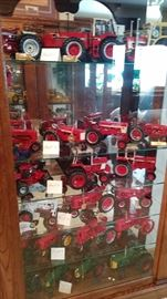 SHELF 1= FARMALL PRECISION, 1206, 3588, 1468, SHELF 2= 400 CULIVATOR WITH UMBRELLA, 1966 IH 450, IH560, 1939 FARMALL M, SHELF 3= CASE 450, IH 1060, IH 756, SHELF 4=WHITE FARMALL FIRST IN FIELD, FARMALL H, FARMALL A, SHELF 5=1946-55 MASSY HARRIS M44, 44, F20, H STEEL WHEEELS, SHELF 6= OLIVERS #10 1954 SUPER 77, #5 1957 SUPER 77, #4 1950 77, DIESEL SUPER 99