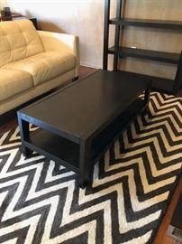 "West Elm coffee table, Pottery Barn brown-and-white zigzag-pattern rug (96"" x 60"")"
