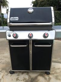 Weber Genesis gas grill on wheels