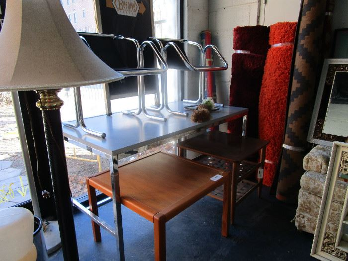 Tables, lighting,  chrome chairs, rugs, wall mirrors