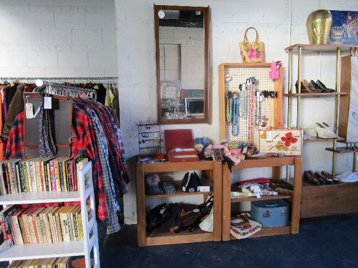 Men's and women's clothing, purses, jewelry, MCM wall mirrors, paperback books (far right shelving unit not available)