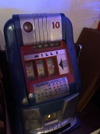 Who will win the jackpot with this Mills 10 cent one armed bandit.  (Oh, yes... we are leaving the coinage within.)