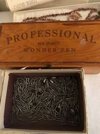 Vintage Wonder pen, and a box of dental bits.
