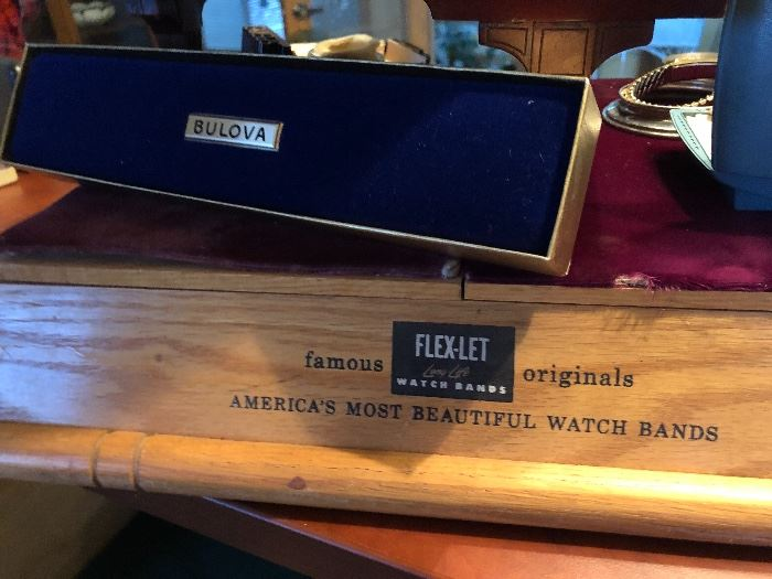 Cool old watch band display tray.  (And empty velvet boxes)