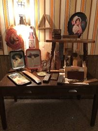 Nice large work desk in basement, along with stage two of the cribbage revolution.  And some great old tin trays