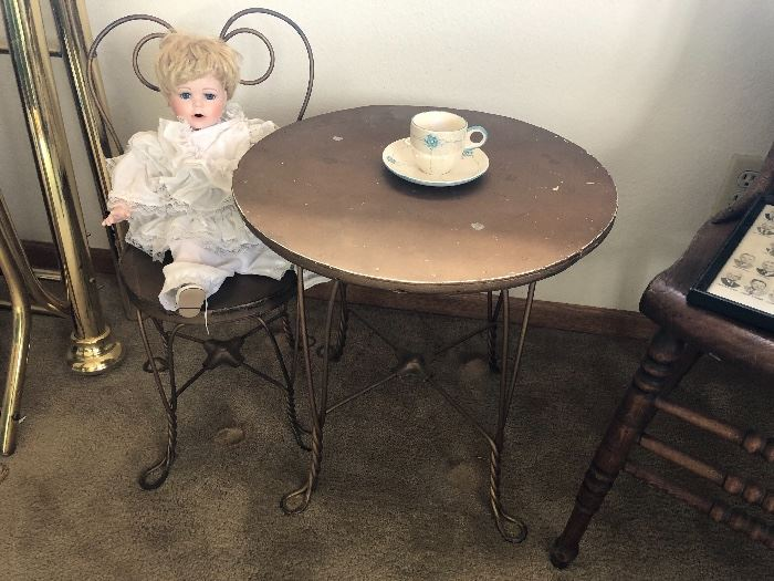 Little child's icecream table and chair... also needs a little love, but this little gal doesn't seem to mind