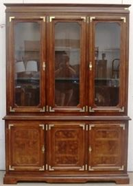 Brass adorned china cabinet