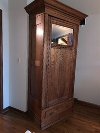Stunning, tall,  thin armoire with mirror.