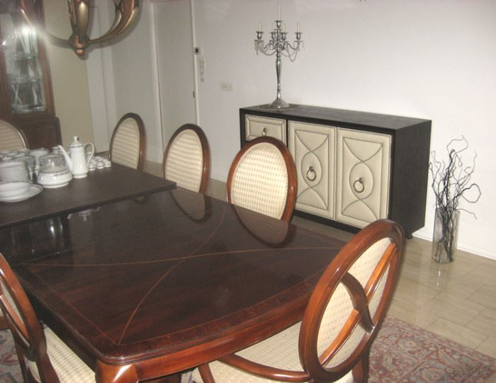 Table shows 2 leaves, 8 chairs includes 2 armed captain's chairs