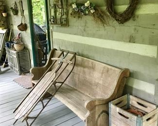 vintage sled, old church pew, wood crates