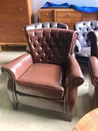 Pair brown leather tufted back chairs
