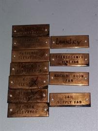Copper label plates include Jail Supply Fan, Prison Elevator