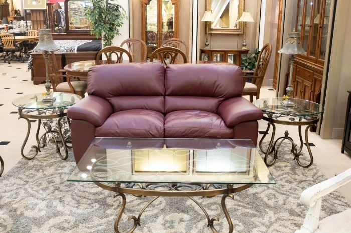 Leather loveseat, wrought iron glass coffee tables.
