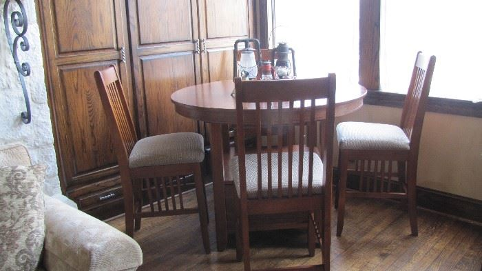 High top table with 4 Chairs.  Table has storage drawer