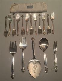 Georg Jensen sterling in Acanthus pattern: 12 salad forks, 2 serving forks, fish server, serving spoon. Also 2-tine Jensen fork in Acorn pattern.