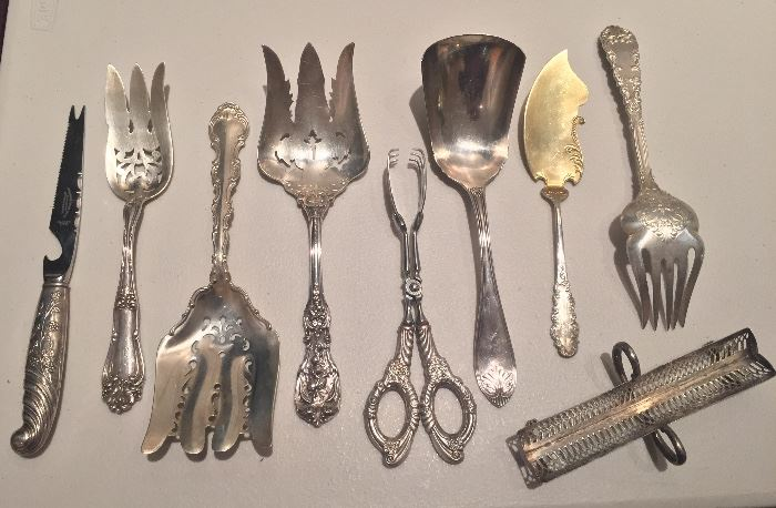 Antique sterling serving pieces including pierced forks, sterling handle tongs & sugar cube tray