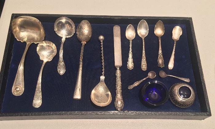 More sterling: ladles, tea strainer, demitasse spoons, cobalt glass salt cellars with sterling bases