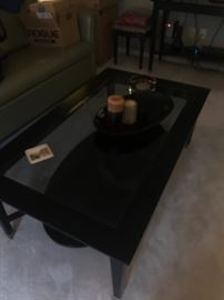 Wood with glass coffee table which also has additional matching pieces available!