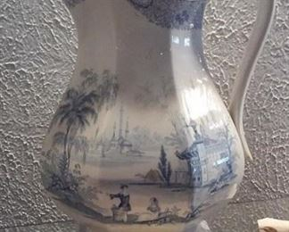 Large old antique blue willow ware pitcher