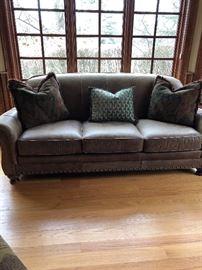 Leather three cushion sofa