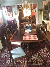 "CIRCA 1940'S SATIN MAHOGANY DINNING TABLE WITH INLAID WOOD BORDER IN GREAT SHAPE 3 LEAFS THAT EXTEND APPROXIMATELY 20"" EACH"