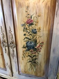 CLOSE UP VIEW OF HAND PAINTINGS OF HAND PAINTED WOOD CORNER CABINET WITH 4 DOORS AND MULTIPLE SHELF'S