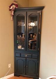 Corner cabinet in dark green