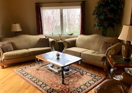 Pair upholstered sofas, Area rugs, tables & leather chair