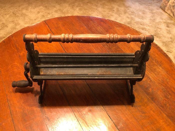 Vintage Cast Iron Newspaper Log Roller