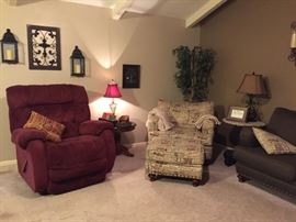 Large recliner, end tables, chair & 1/2 plus ottoman, lamps, couch, ficus tree