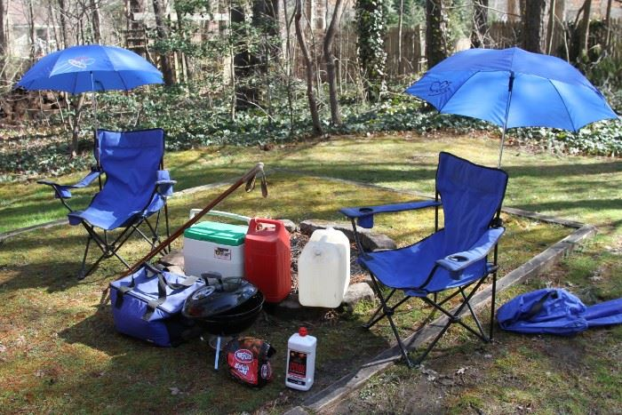 Grouping of 2 captains chairs, coolers, Coleman gas lantern and case, Weber hibachi grill with charcoal and full, 6 gal water jug, and bamboo hiking poles.