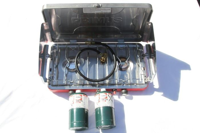 Primus  folding 2 burner camping portable stove with propane tanks. Like new.