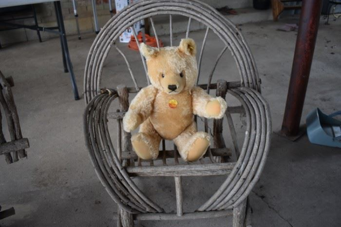 """Steiff"" Teddy Bear with an original paper tag and tag in the ear. Notice also the antique tree limb child's chair."