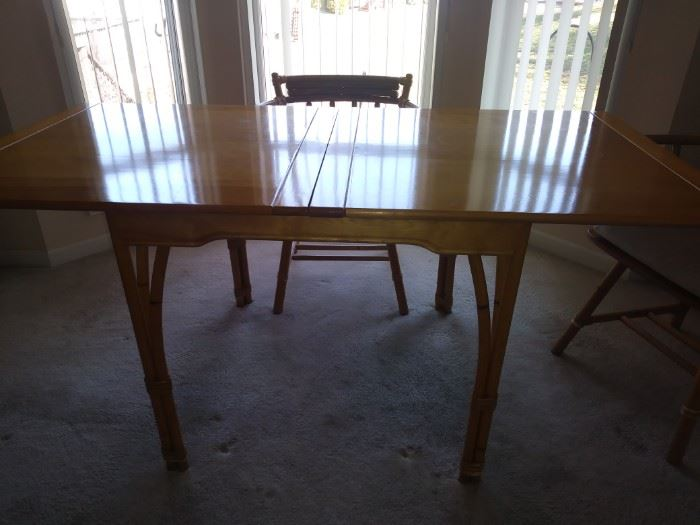 Bamboo style legs on this versatile table