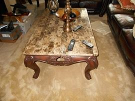 Low and large marble-top coffee table