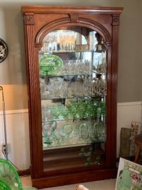 One of three beautiful slide front lit glass display cabinets