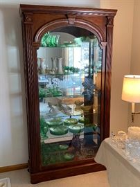 The second of three beautiful slide front lit glass display cabinets