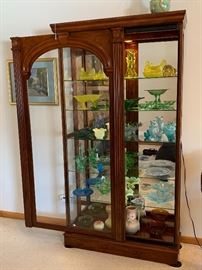 The third of three beautiful slide front lit glass display cabinets