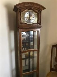 Floor battery operated clock with glass shelves