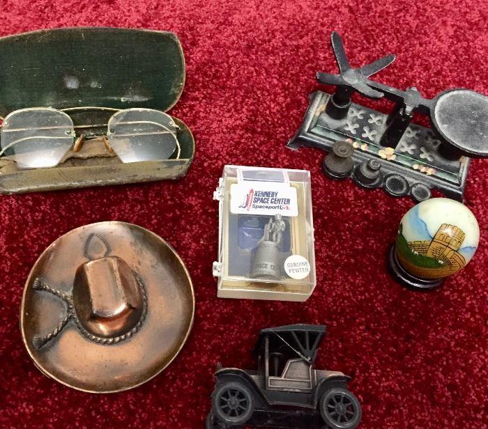Antique glasses, mini cast iron scale, coy boy hat ashtray, pewter souvenir thimble, souvenir marble egg from China, vintage tin-lizzy sharpener