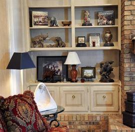 Bookshelf features many elephants along with Kutani porcelain pieces