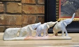 Wonderful artist signed stone carving of a train of elephants emerging from stone - African in origin