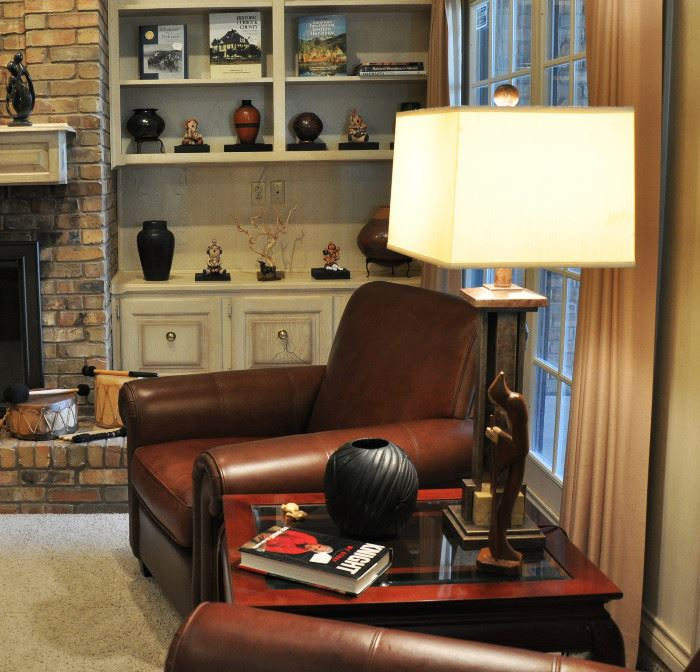 One of a pair of leather club chairs by Bernhardt (orig cost $700 ea), Santa Clara pot and autographed Bobby Knight book